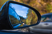 Objects in mirror are closer than they appear on car with Blind Spot Assist Warning LED Sensor Light