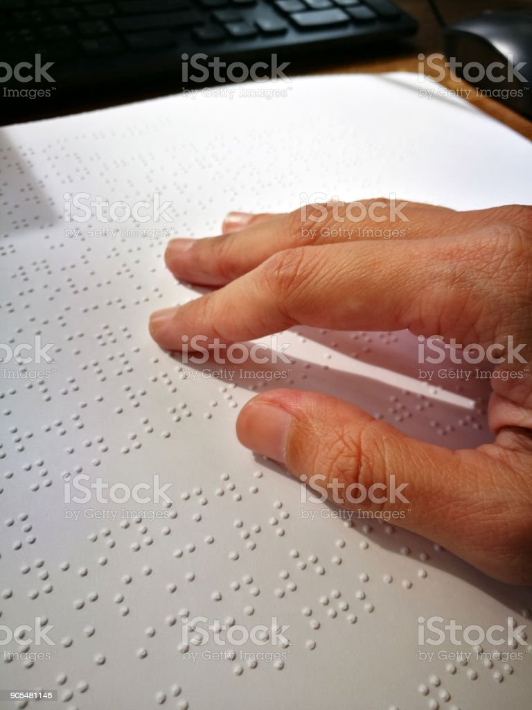 Blind Woman Read Book Written In Braille. Close Up Finger Touch To Braille Code stock photo