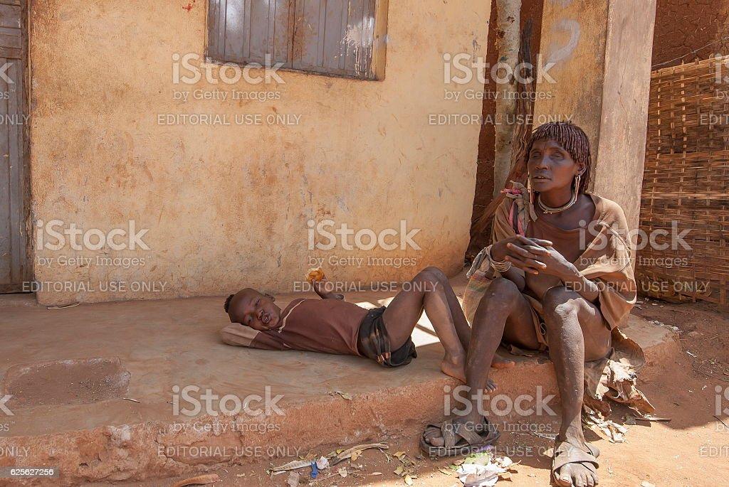 Blind woman takes a rest in Dimeka, Valley Omo, Ethiopia. stock photo