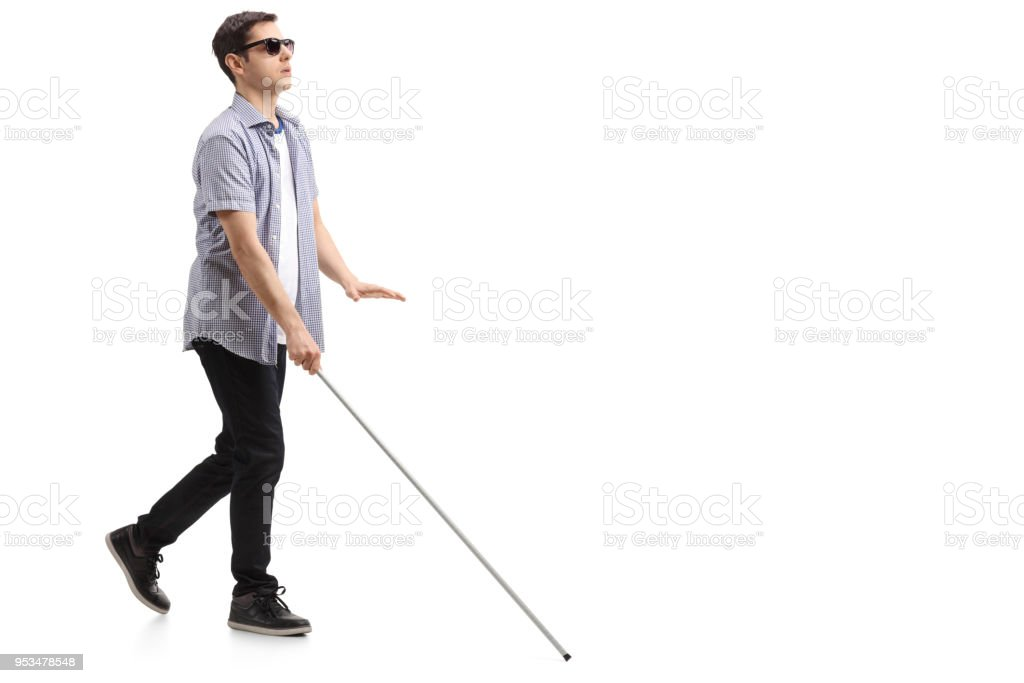Blind young man with a cane walking stock photo