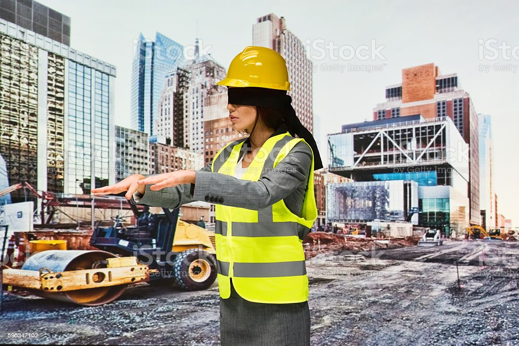 Blindfold building contractor searching outdoors royalty-free stock photo