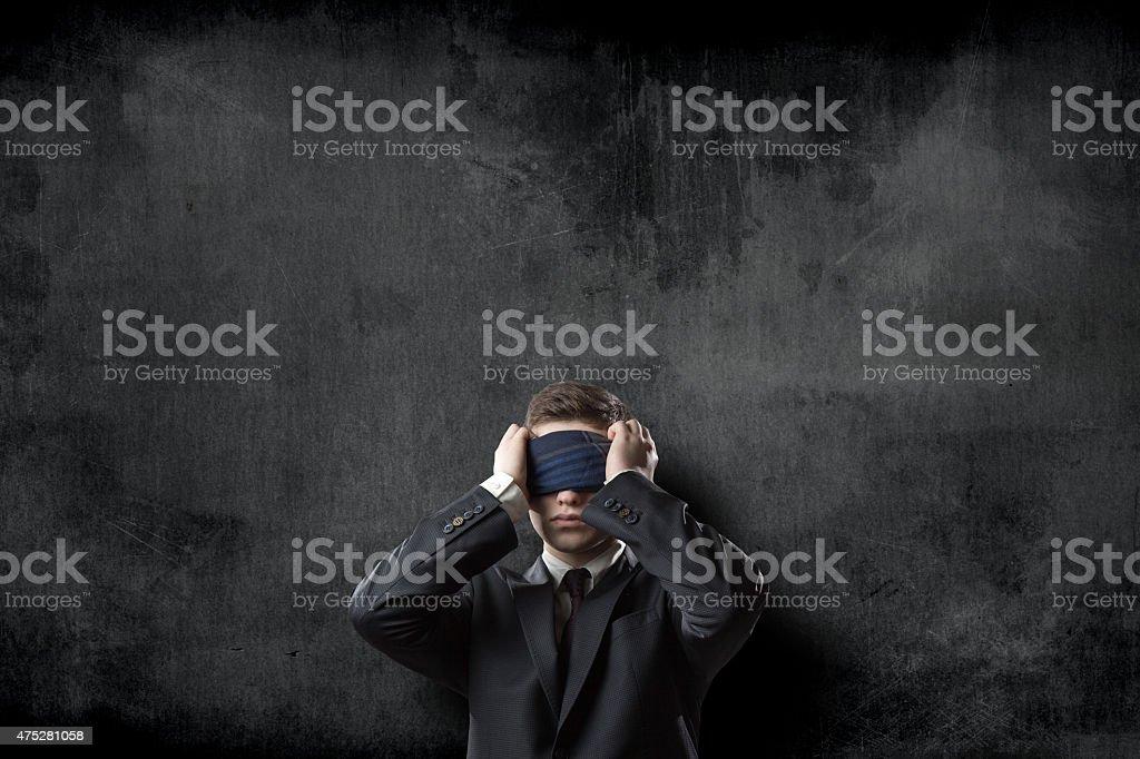 Blindfold businessman on blackboard background stock photo
