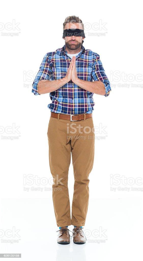Blindfold man meditating stock photo