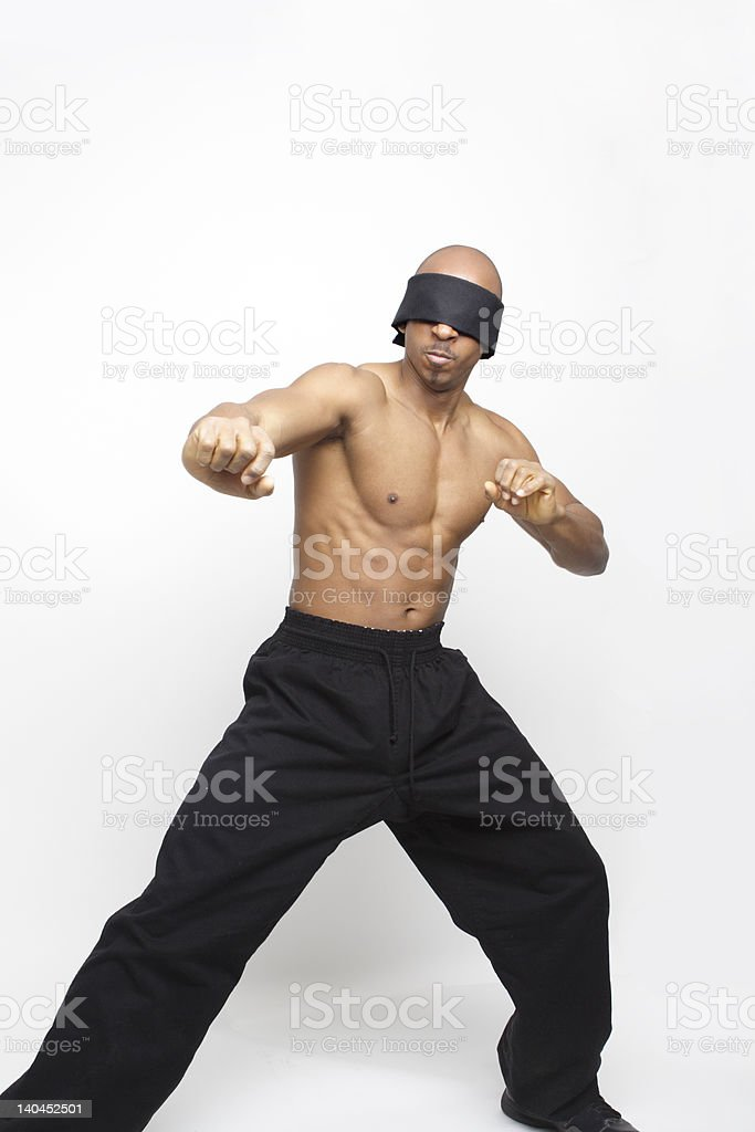 Blindfolded African American Man Shadowboxing Martial Arts Isolated Gray Background royalty-free stock photo