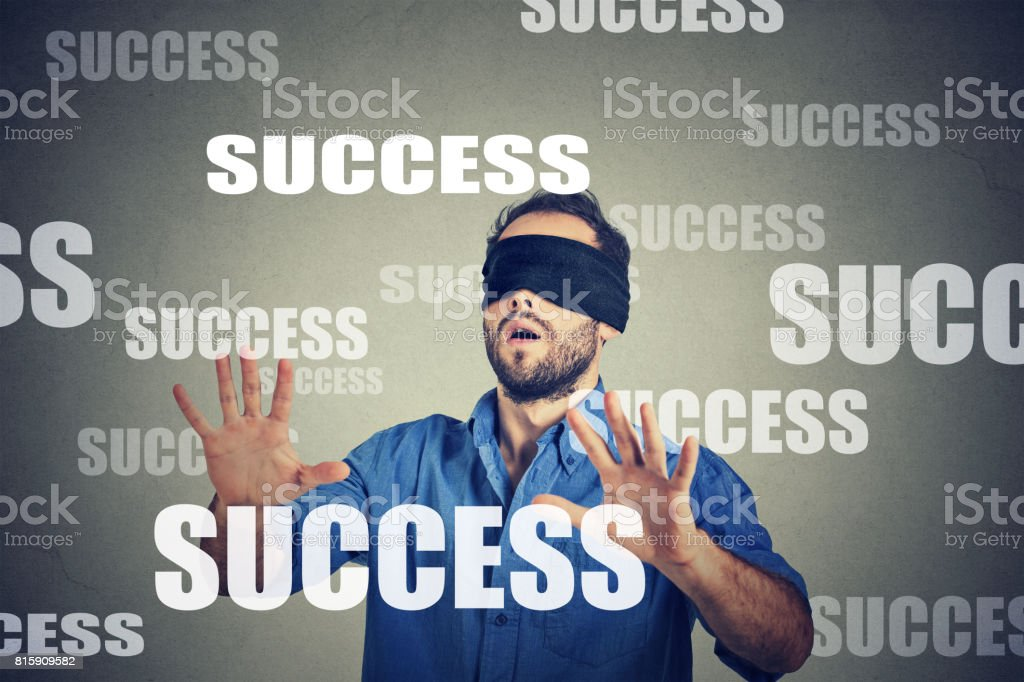 Blindfolded business man looking for success stock photo