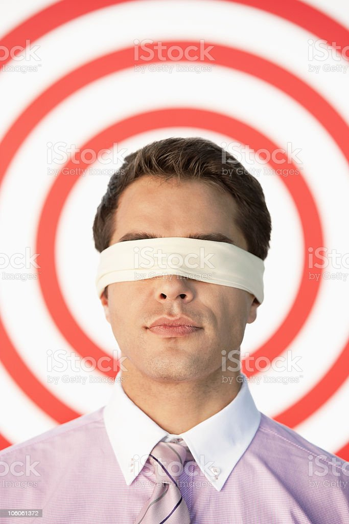 Blindfolded businessman in front of target royalty-free stock photo