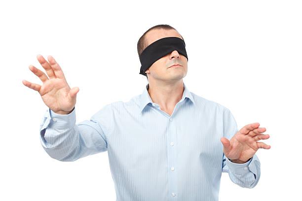 Blindfolded businessman stock photo