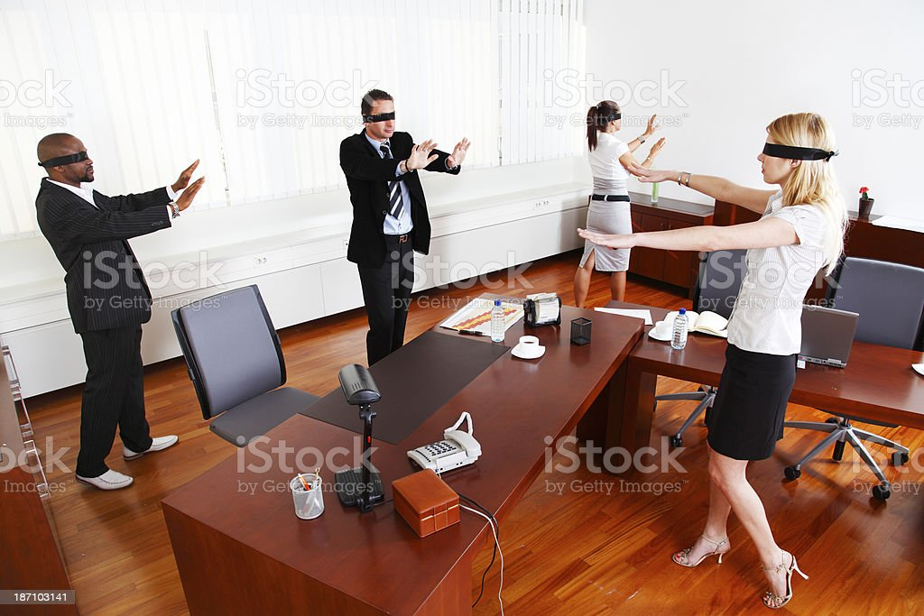 Blindfolded businesspeople in an office stock photo