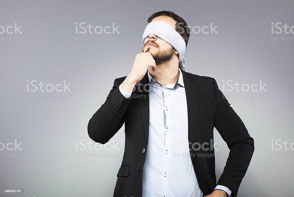 Blindfolded elegant man stock photo