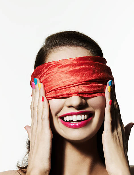 Blindfolded girl with bright nail polish stock photo