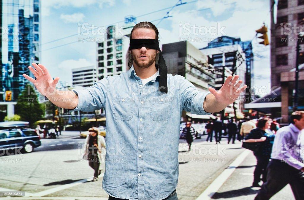 Blindfolded man on road stock photo