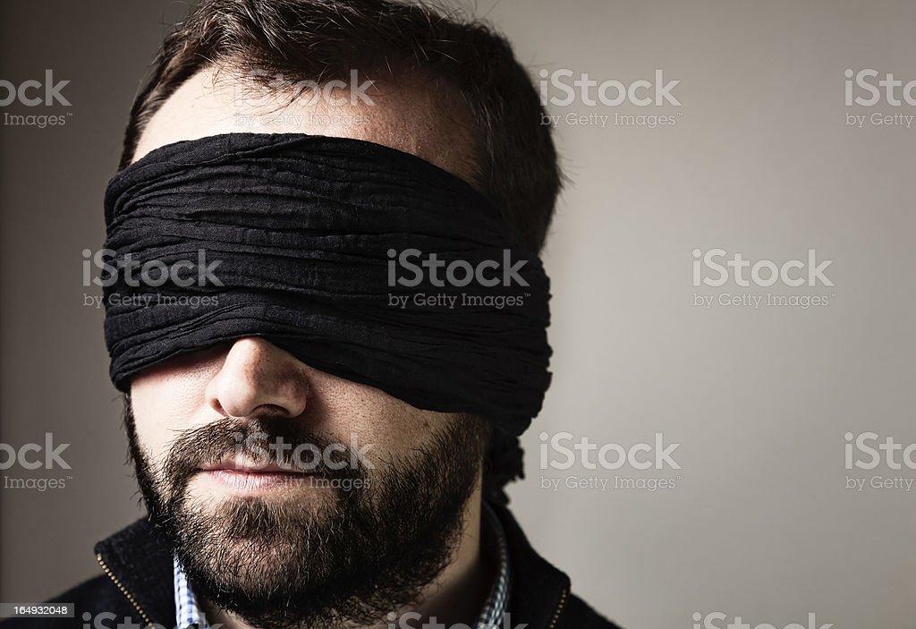 Blindfolded man portrait stock photo