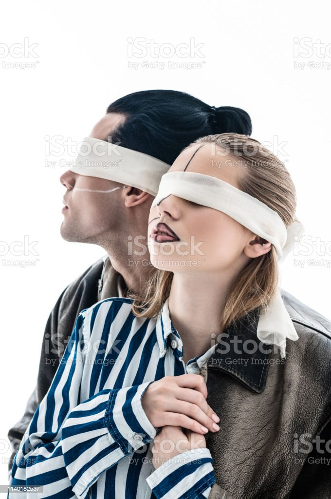 Creative photo. Young talented blindfolded models taking part in very...