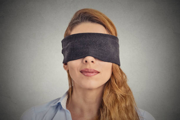Blindfolded red haired woman stock photo