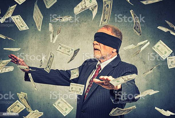 Blindfolded senior businessman trying to catch dollar bills banknotes picture id485010904?b=1&k=6&m=485010904&s=612x612&h=qllgnmgm3gharii7wqmacekdxsbk5r6z1cinjvuqsre=