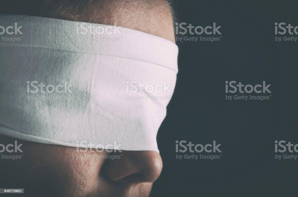 Blindfolded woman stock photo