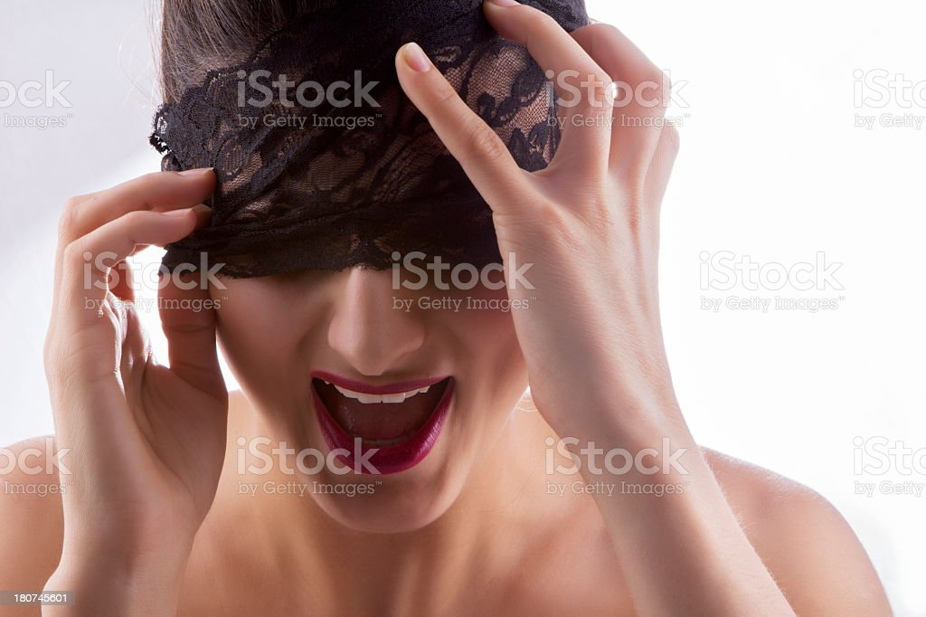 Blindfolded woman shouting royalty-free stock photo