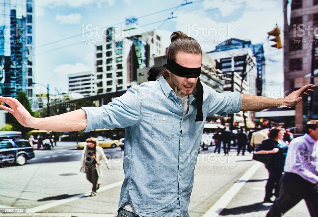 Blindness man searching outdoors stock photo