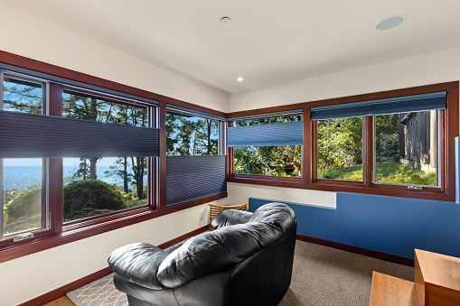Window coverings in home with view of the ocean