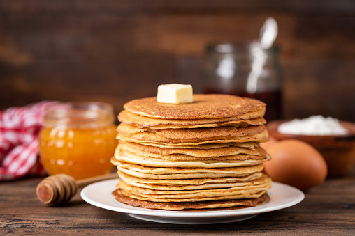 Blini or crepe stack on wooden table