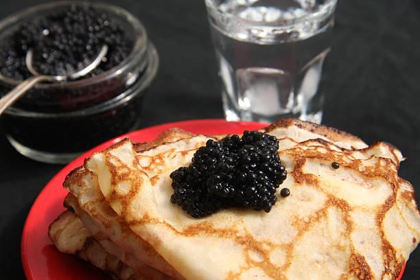 Blini, vodka and black caviar stock photo