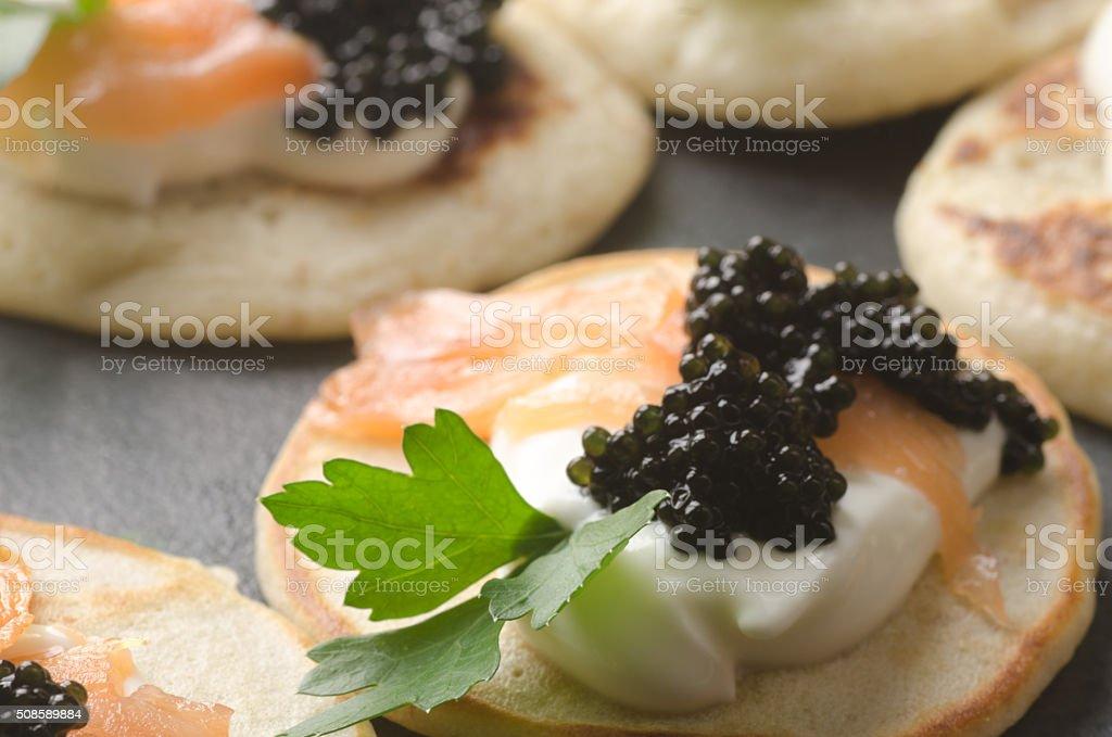 blini with caviar and smoked salmon stock photo