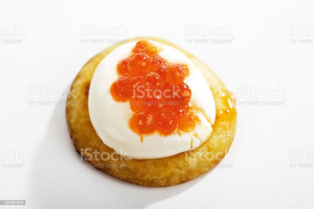 Blini with sour cream and caviar stock photo