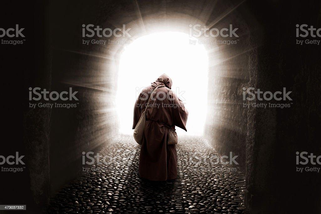 blissed Friar with faith illuminated by god stock photo