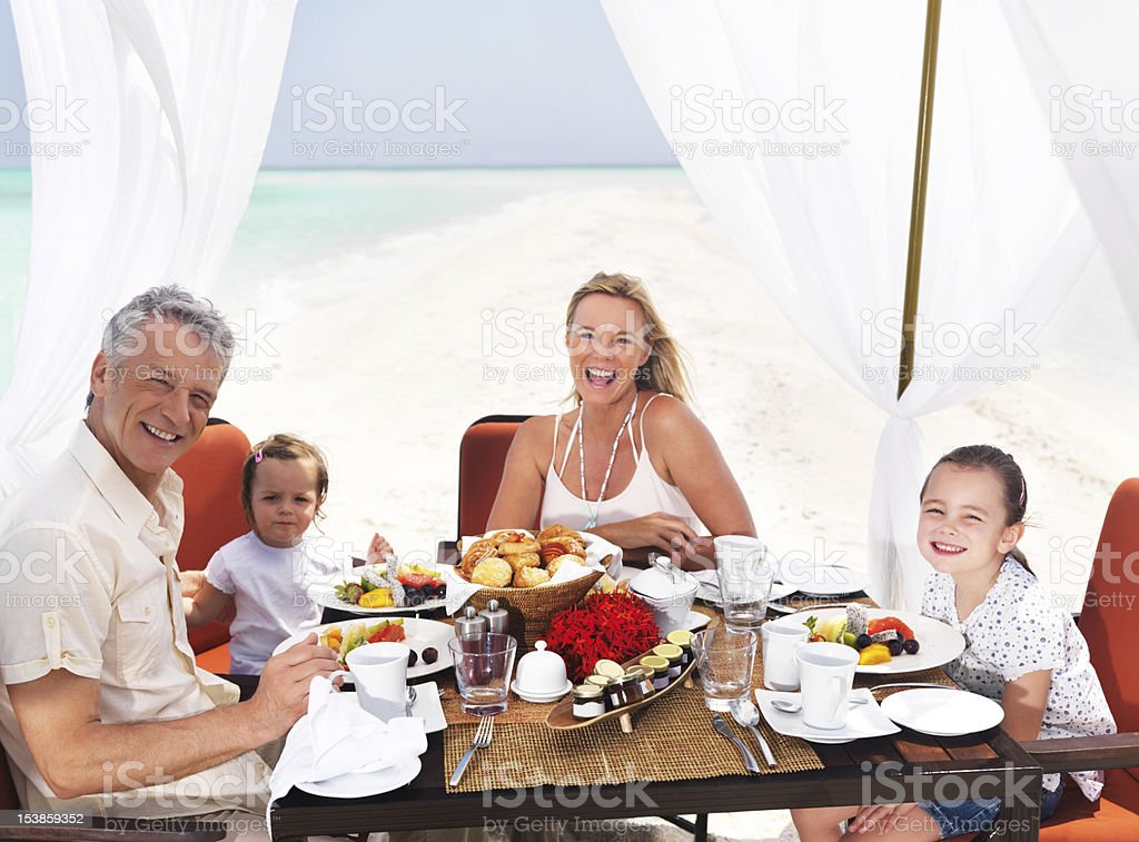 Blissful family in paradise royalty-free stock photo