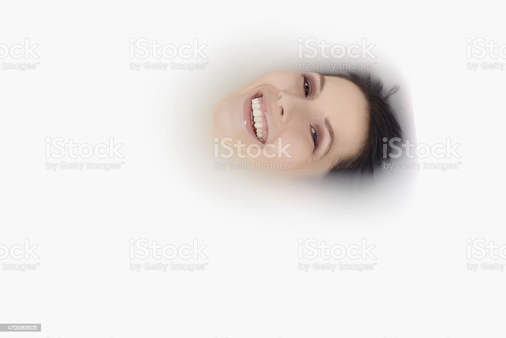 Blissful woman soaking in a hot bath royalty-free stock photo