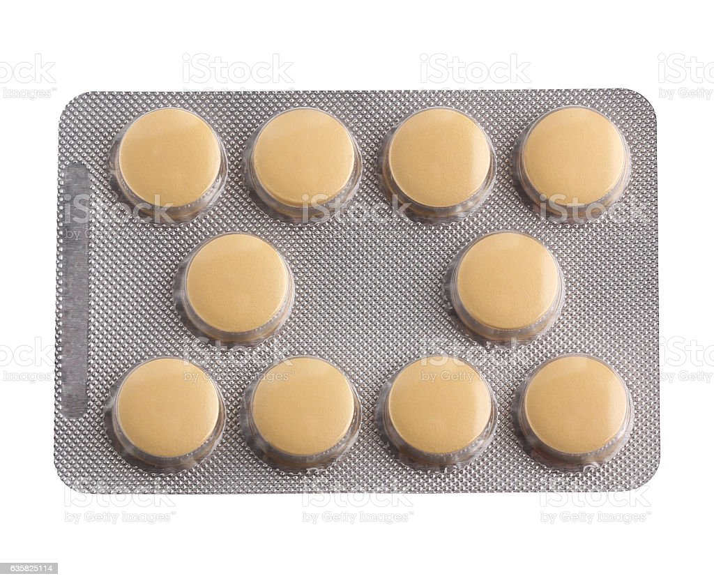 Blister pack of yellow tablets, isolate. stock photo