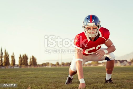 A linebacker prepares to blitz.