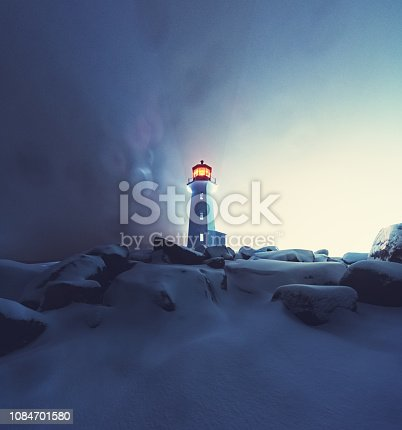 A blizzard envelopes Peggy's Cove Lighthouse.