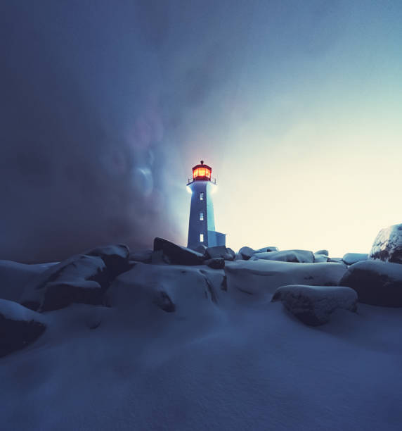 Blizzard at Peggy's Cove Lighthouse A blizzard envelopes Peggy's Cove Lighthouse. beacon stock pictures, royalty-free photos & images
