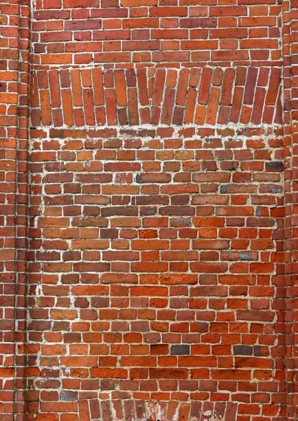 block background . old brick wall of red bricks stock photo