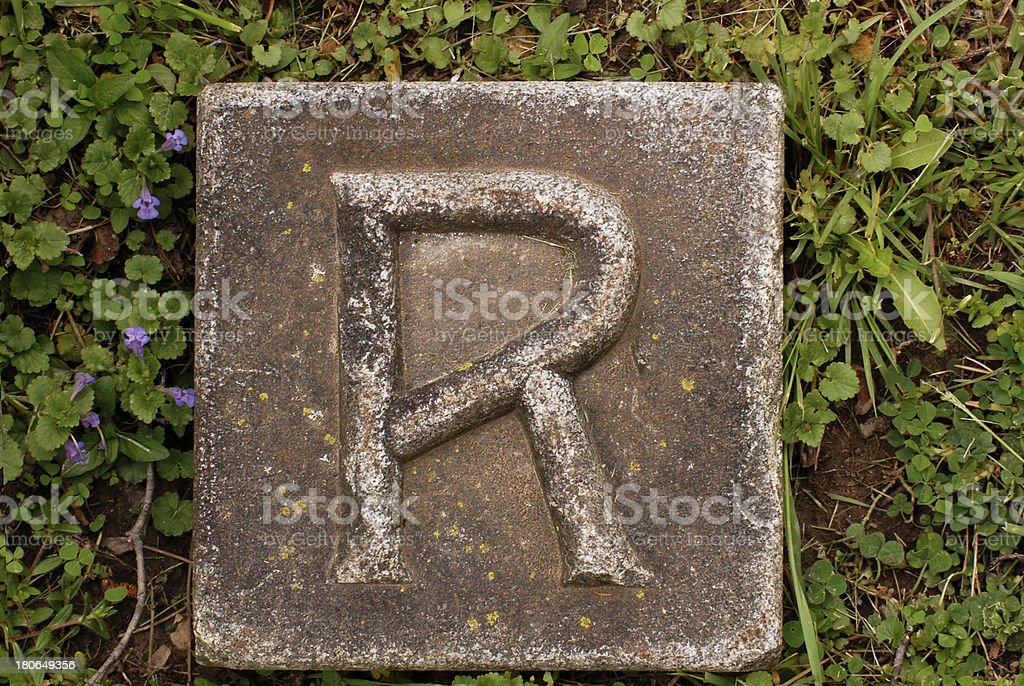 Block letter R in ground royalty-free stock photo