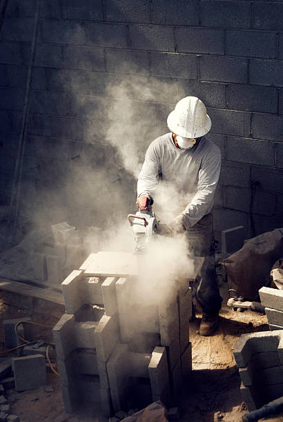 Block Mason cutting  pollution mask stock pictures, royalty-free photos & images