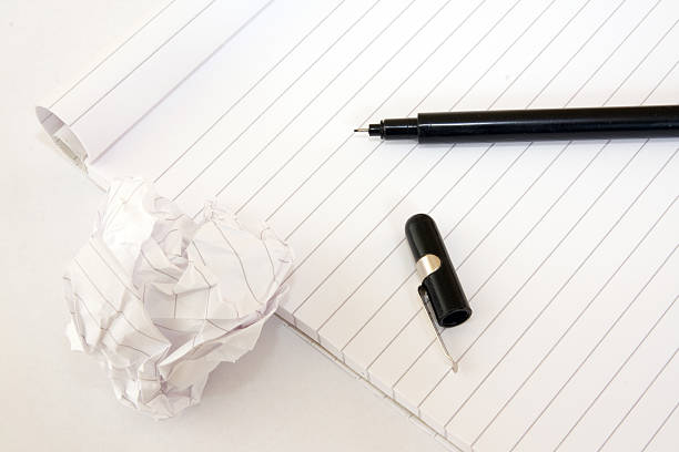 Block note with black pen stock photo