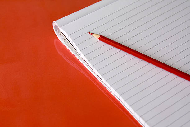 Block note with red pencil stock photo