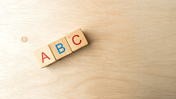 block of alphabet letters forming marketing-related words - disbursement stock pictures, royalty-free photos & images