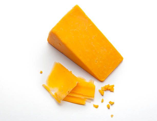block of cheddar cheese - sharp stock photos and pictures