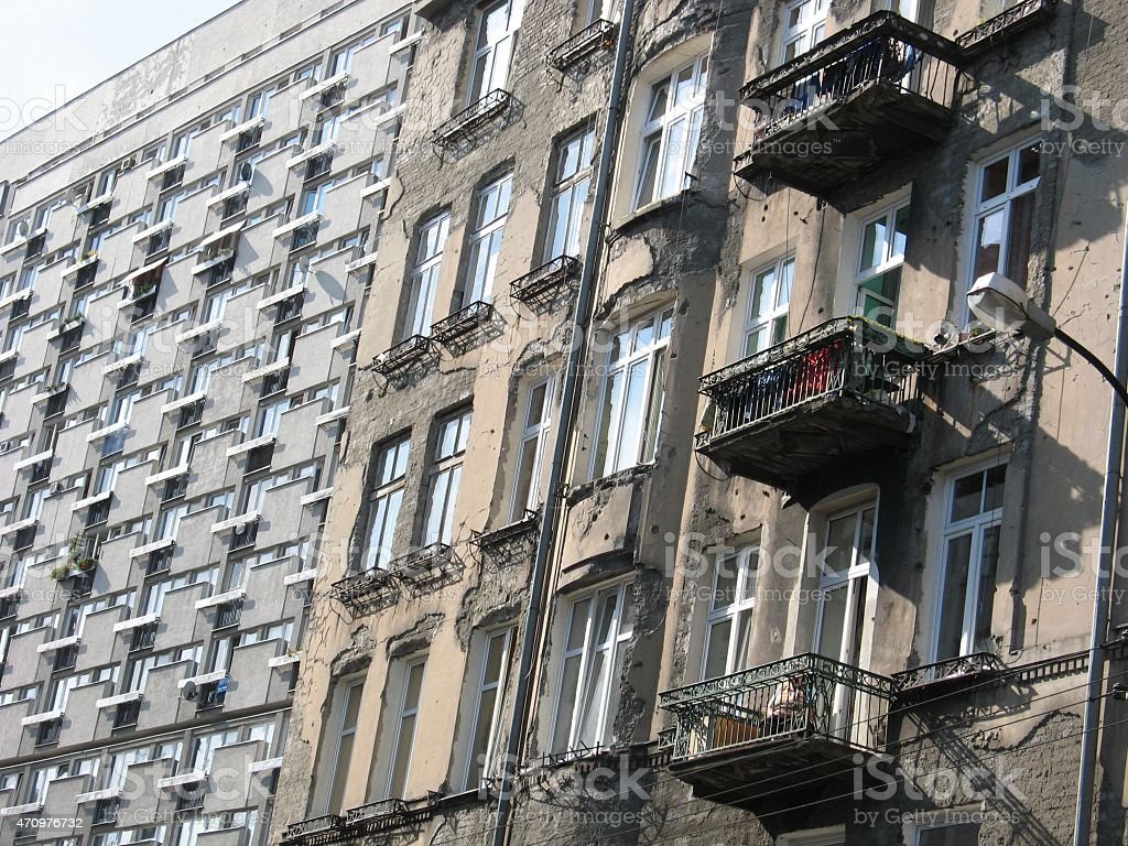 Block of flats and ruined house stock photo
