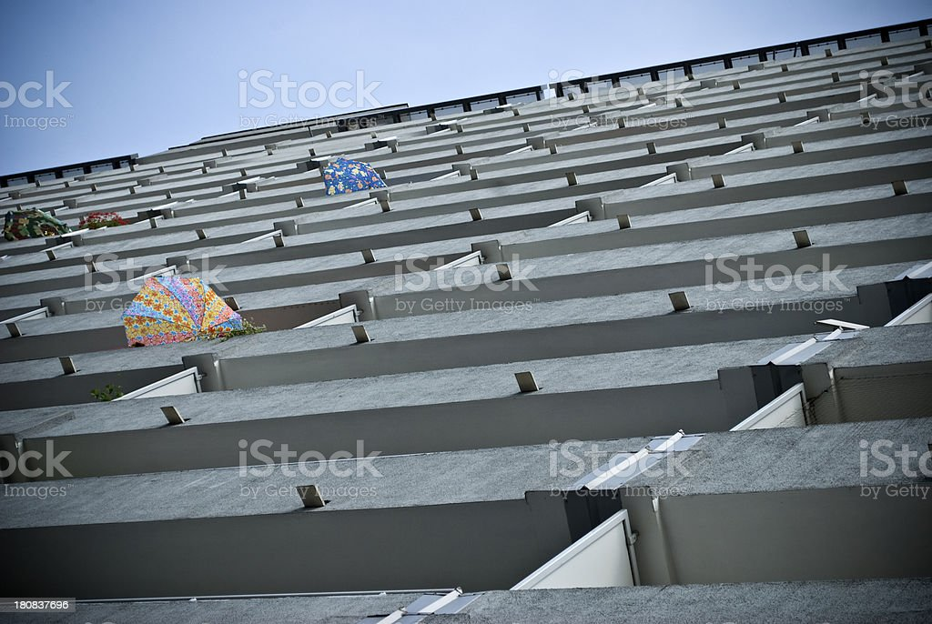 Block of flats and umbrellas on the balconies summer day royalty-free stock photo