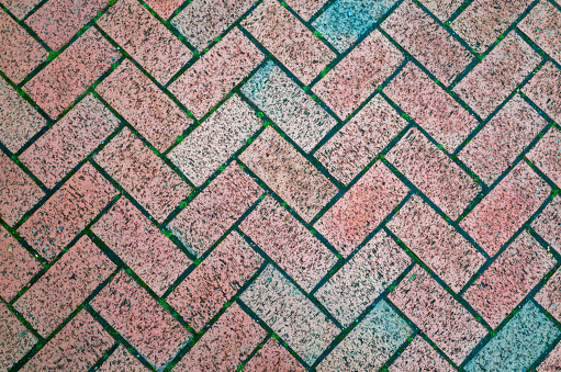 Block paving bricks in a herringbone pattern