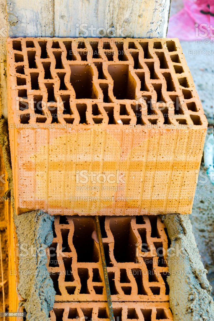 Block poroton placed on a bed grout on a bricklayer. Depth of field is shallow stock photo