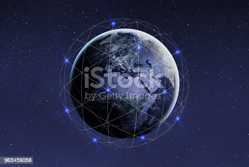 878855462istockphoto Blockchain and cryptocurrency concept. Global international business network and communication. Earth with satellites with copyspace. Elements of this photo furnished by NASA. 963459056