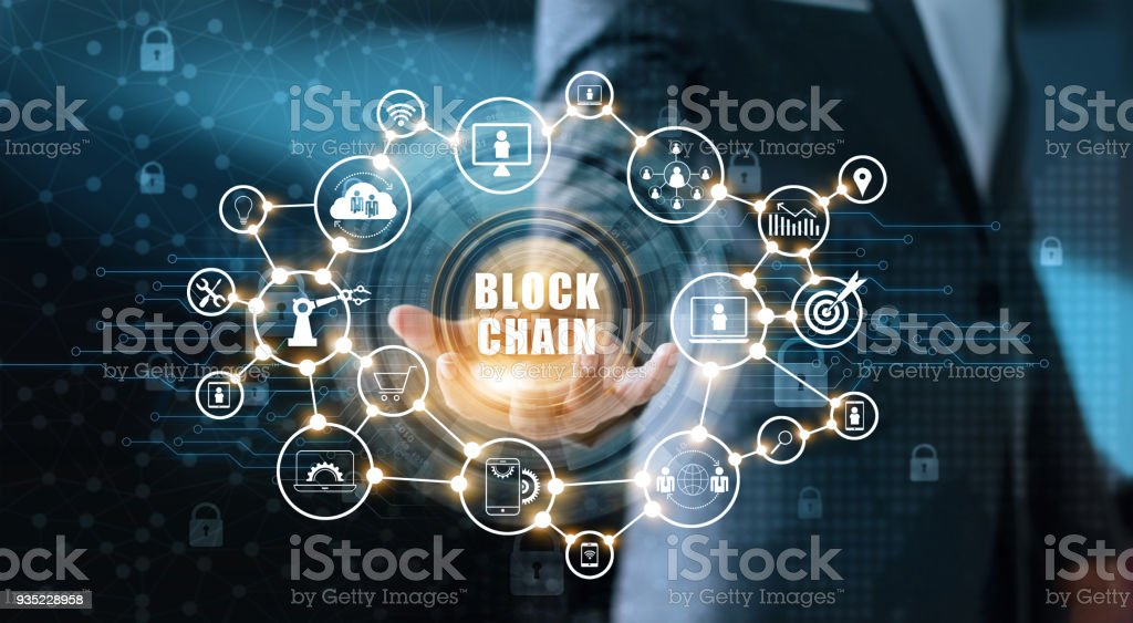 Blockchain technology and network concept. Businessman holding text blockchain in hand with icon network connection on blue security  and digital connection background stock photo