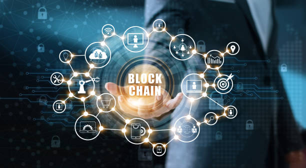 blockchain technology and network concept. businessman holding text blockchain in hand with icon network connection on blue security  and digital connection background - blockchain foto e immagini stock