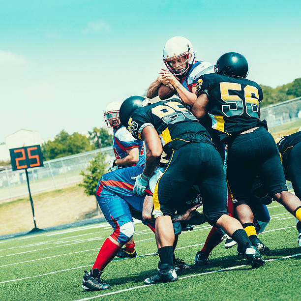 Blocked American Football Player stock photo