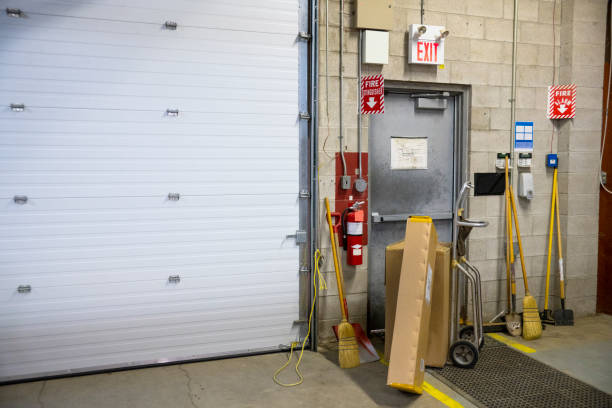 A blocked fire exit door in a warehouse A blocked fire exit door in an industrial building such as a warehouse or factory.  Blocked fire exits are very dangerous and they are in violation of safety regulations. covering stock pictures, royalty-free photos & images